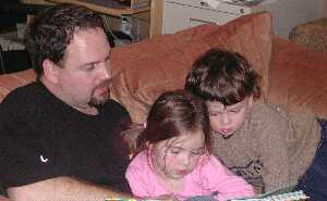 Kate, Kieran, and Daddy Reading